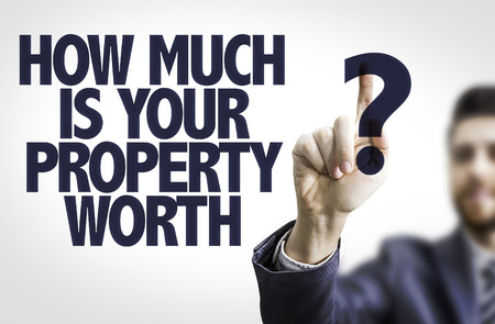 financial questions: Business man pointing to transparent board with text: How Much is your Property Worth?