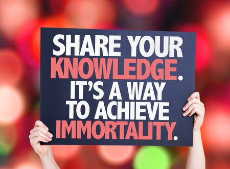 immortality: Hands holding Share Your Knowledge. Its a Way to Achieve Immortality card with bokeh background Stock Photo