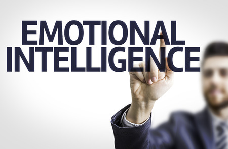 emotionality: Business man pointing to transparent board with text: Emotional Intelligence