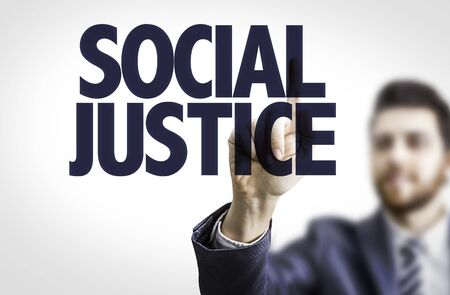 judgements: Business man pointing the text Social Justice