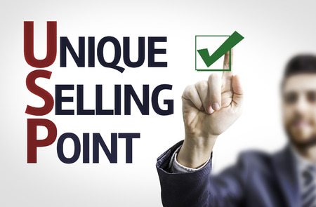 usp: Business man pointing the text Unique Selling Point Stock Photo