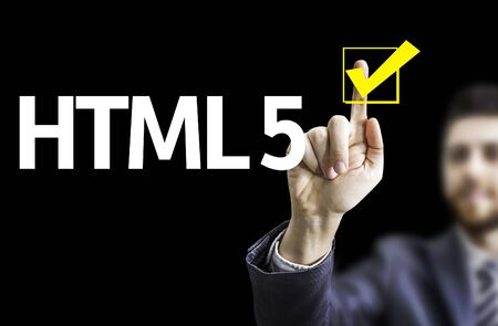 html 5: Business man pointing the text HTML 5 with black background Stock Photo