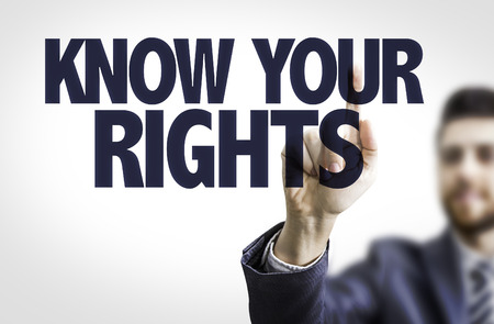 consumer rights: Business man pointing to transparent board with text: Know Your Rights Stock Photo