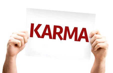 karma: Hands holding Karma card isolated on white background Stock Photo