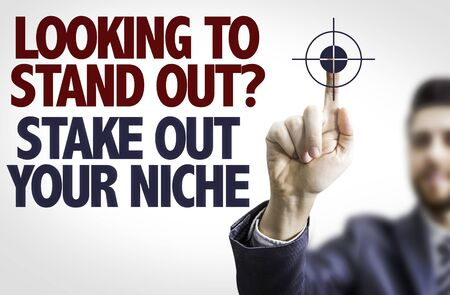 stand out: Business man pointing the text: Looking to Stand Out? Share Out Your Niche