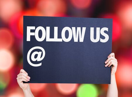 newsfeed: Follow Us with a copy space card with bokeh background Stock Photo