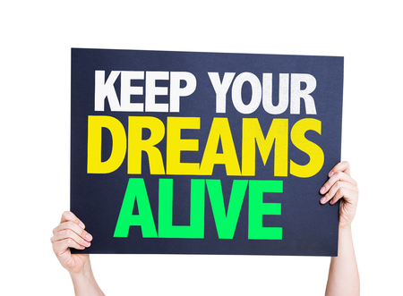 keep your hands: Hands holding Keep Your Dreams Alive card isolated on white
