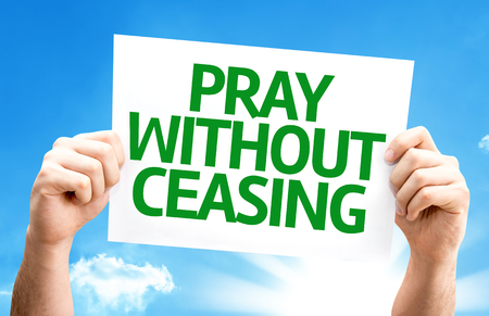 ceasing: Hands holding Pray Without Ceasing card with sky background
