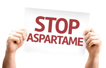 aspartame: Hands holding Stop Aspartame card isolated on white background