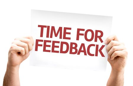 criticize: Hands holding Time for Feedback card isolated on white background