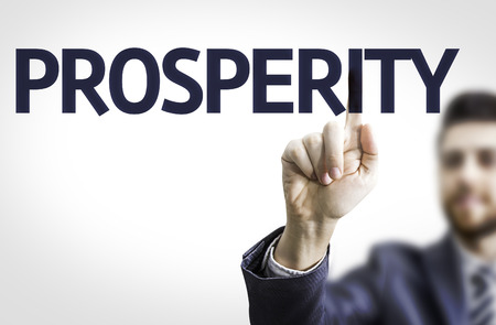 affluence: Business man pointing to transparent board with text: Prosperity