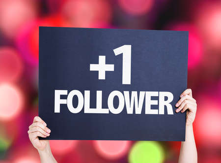 follower: Hands holding +1 Follower card with bokeh background