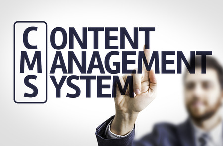 ecm: Business man pointing to transparent board with text: Content Management System