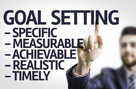 achievable: Business man pointing to transparent board with text: Description of Global Setting