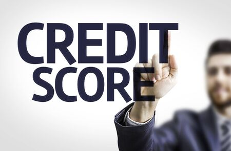 Business man pointing to transparent board with text: Credit Score Standard-Bild