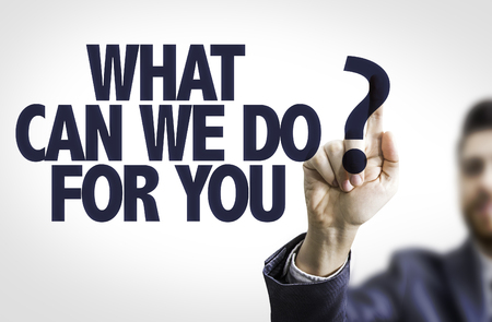 Uomo di affari che indica il testo: Che cosa possiamo fare per voi? Archivio Fotografico - 55008073