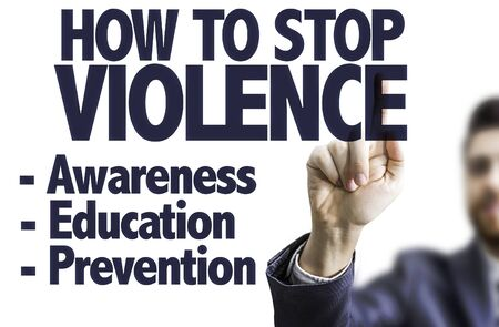 how to: Business man pointing the text: How to Stop Violence Stock Photo