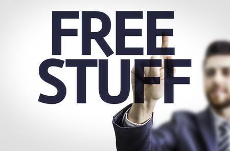 goody: Business man pointing to transparent board with text: Free Stuff