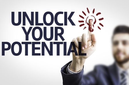 Business man pointing to transparent board with text: Unlock Your Potential Stock Photo