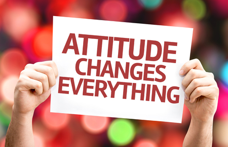 beliefs: Hands holding Attitude Changes Everything card with bokeh background Stock Photo