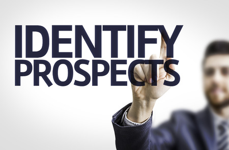 identify: Business man pointing to transparent board with text: Identify Prospects