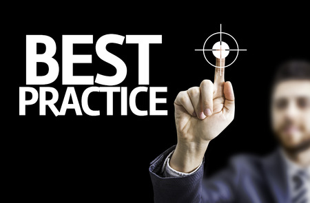 best practices: Business man pointing the text Best Practice with black background