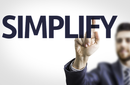 pragmatic: Business man pointing to transparent board with text: Simplify