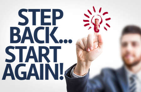 again: Business man pointing to transparent board with text: Step Back Start Again Stock Photo