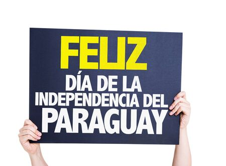 Hands holding Happy Paraguay Independence Day (in Spanish) card isolated on white Stock Photo