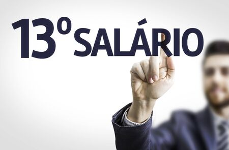 monetizing: Business man pointing to transparent board with text: 13 Salary (In Portuguese)
