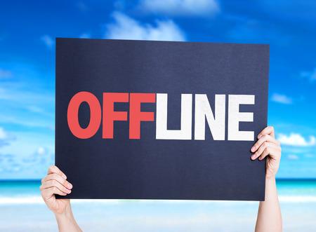 offline: Hands holding Offline card with beach background