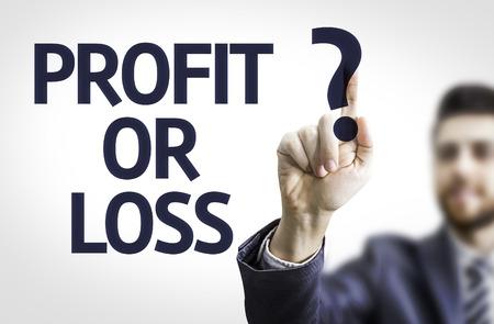 perdidas y ganancias: Business man pointing to transparent board with text: Profit or Loss? Foto de archivo
