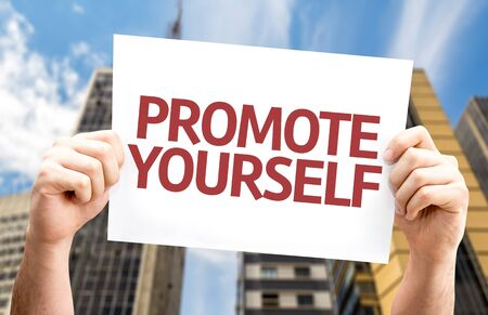promote: Promote Yourself card with a urban background Stock Photo
