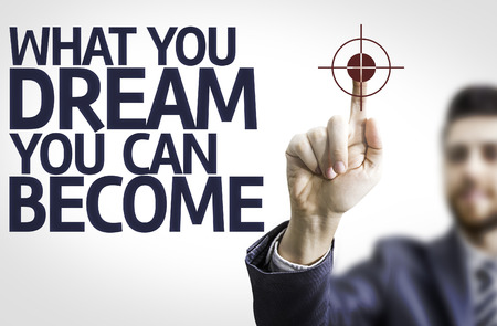 become: Business man pointing to transparent board with text: What You Dream You Can Become Stock Photo