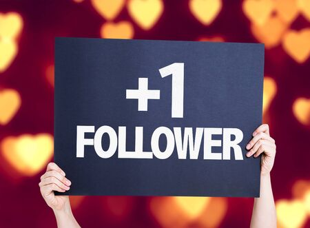 follower: Hands holding +1 Follower card with heat bokeh background