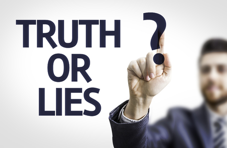 falsehood: Business man pointing the text Truth or Lies Stock Photo