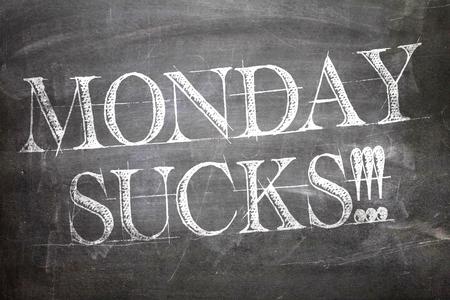 sucks: Monday Sucks written on blackboard