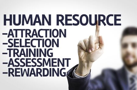 rewarding: Business man pointing to transparent board with text: Human Resources