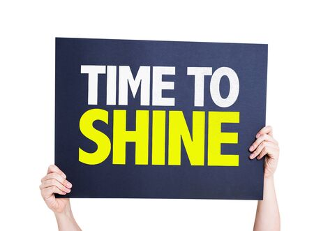 time to shine: Hands holding card with text Time to shine on white background Stock Photo