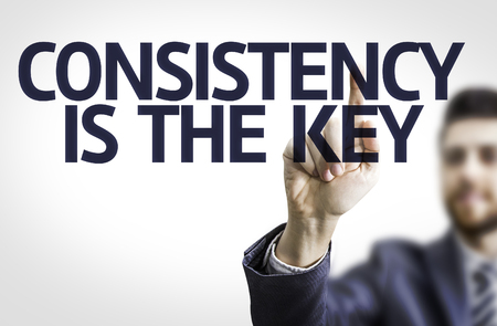consistency: Businessman with text Consistency is the key