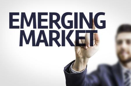 emerging market: Business man pointing the text Emerging Market