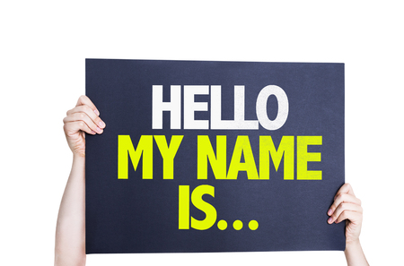 hello my name is: Hands holding card with text Hello My Name Is on white background Stock Photo