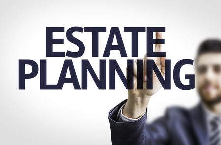 estate planning: Business man pointing the text Estate Planning