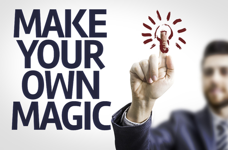 own: Business man pointing the text Make Your Own Magic Stock Photo