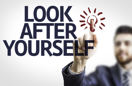 look after: Business man pointing the text Look After Yourself