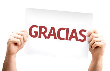 agradecimiento: Tomados de la mano de cartón con el texto de Gracias (gracias en español) sobre fondo blanco
