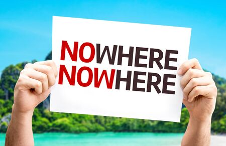 nowhere: Hands holding cardboard with text NoWhere NowHere on island background