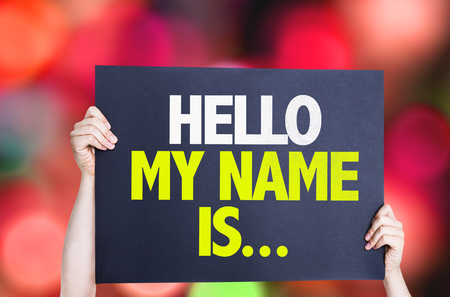 hello my name is: Hands holding card with text Hello My Name Is on bokeh background