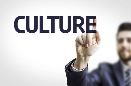 traditional culture: Business man pointing the text Culture