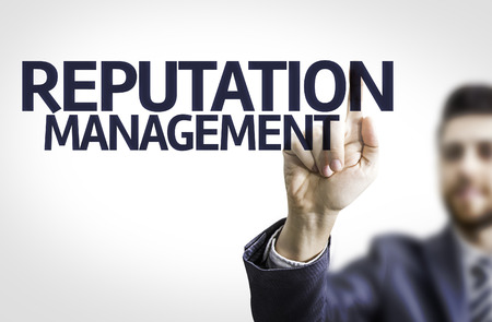 reputable: Business man pointing the text Reputation Management